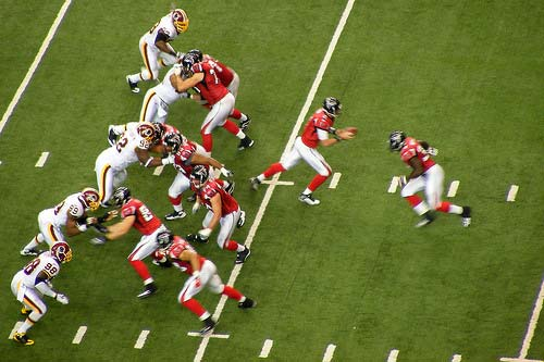 Atlanta Falcons Game Matt Ryan fakes the handoff and prepares to pass