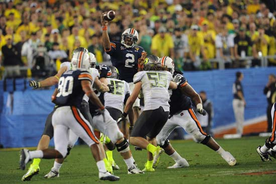 Auburn Tigers QB Cameron Newton passes over the line of scrimmage