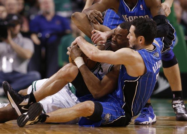 Boston Celtics center Jason Collins and Orlando Magic shooting guard J.J. Redick