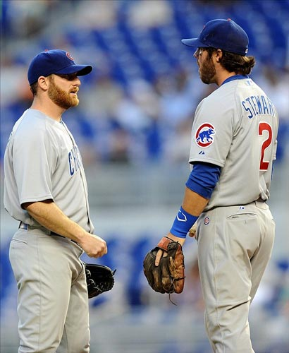 Chicago Cubs starting pitcher Ryan Dempster talks with third baseman Ian Stewart