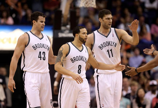 Brooklyn Nets forward Kris Humphries, guard Deron Williams and center Brook Lopez