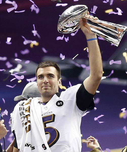 Baltimore Ravens Quarterback Joe Flacco Hoists the Vince Lombardi Trophy