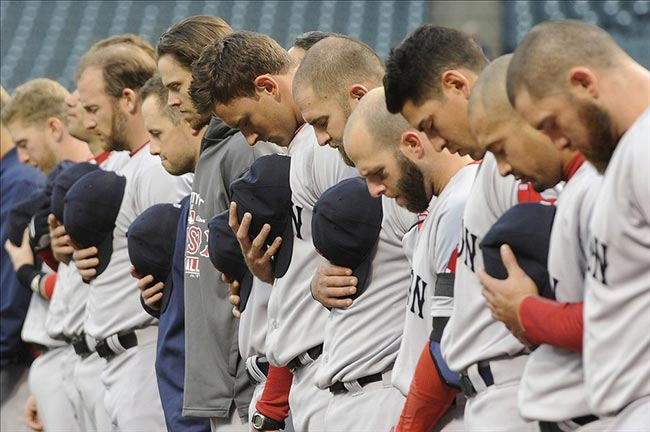The Boston Red Sox bow their heads