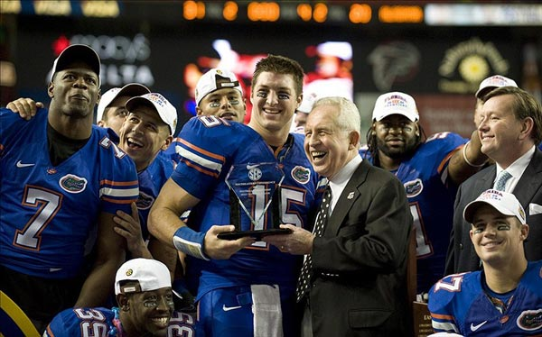 SEC Commissioner Mike Slive Presents Tim Tebow